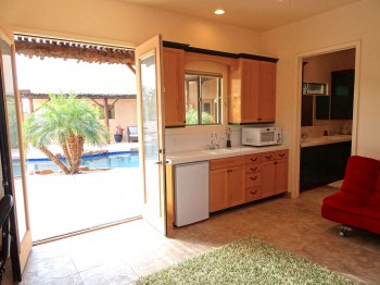Refrigerator, microwave, sink, drinking fountain - it's all here in this kitchenette!