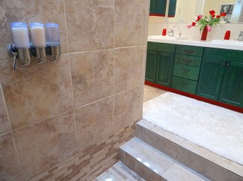 Because the shower is sunken in, the rest of the bathroom stays dry!