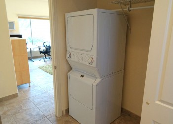 Roomy hall closet, complete with separate water heater and stacked washer/dryer unit!