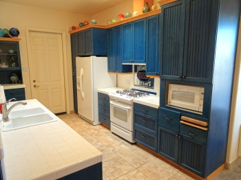 Large, open kitchen with clean, white appliances and TONS of storage!