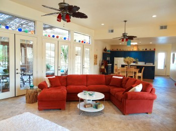 Beautifully accented ceiling fans keep this room cool in the summer