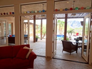 Watch the kids play in the pool from your recliner - every room has a view of the pool and mountains!