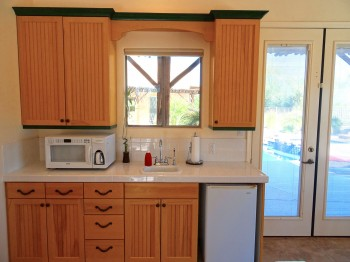 Kitchenette is complete with fridge, microwave, coffee maker, sink, and drinking fountain