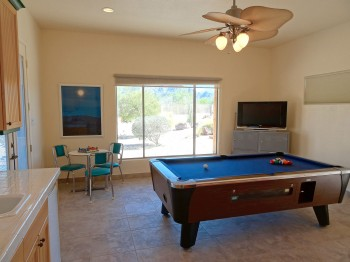 This amazing flex space can be used as a game room!
