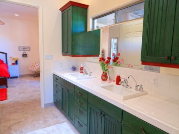 Beautiful custom cabinetry with double sinks and drinking fountains