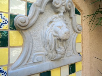 Water dribbles from the lion's mouth into the basin below