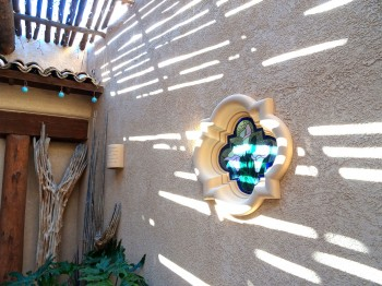 Custom stained glass lilies accent both the north and south walls of the courtyard