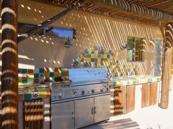 The outdoor kitchen is convenient for entertaining guests