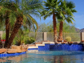 Beautiful Mexican tile surround the pool and hot tub