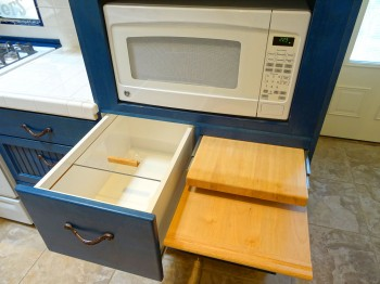 Cutting boards and bread drawers conveniently housed below the microwave